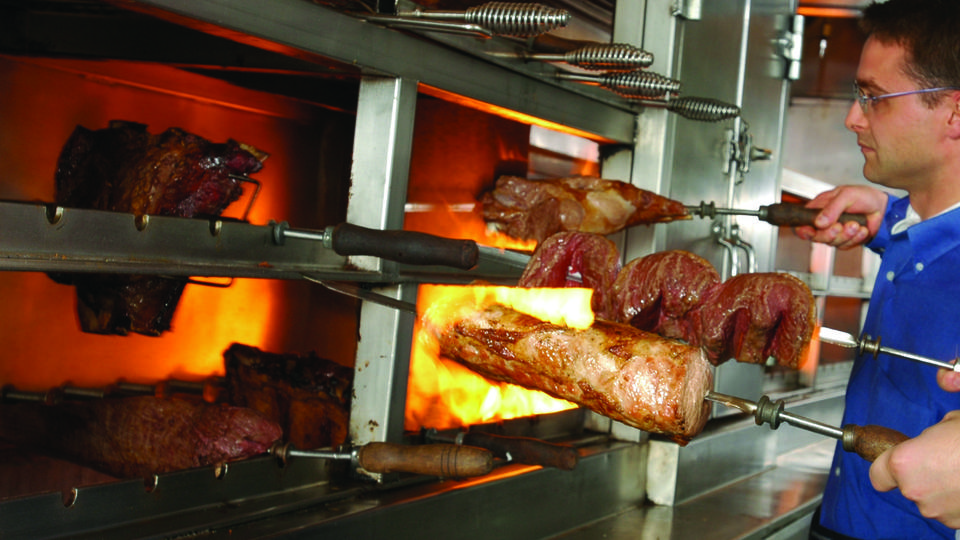 Meats being fire-roasted at Fogo de Chao.  Picture courtesy of the Boston Herald.